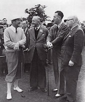 Four golfers chatting